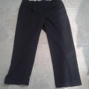 Black men's dress pants. Frayed bottom.